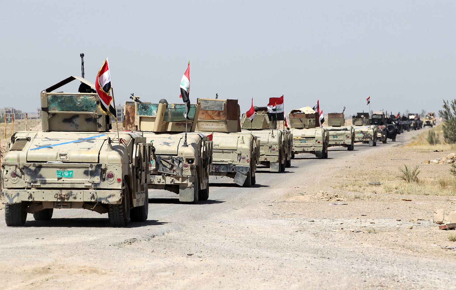 Iraqi government forces take a position outside al-Shuhada neighborhood, south of Fallujah, during an operation to regain control of the area from the Islamic State group on June 3, 2016. Iraqi forces on May 22-23 launched a vast offensive aimed at retaking the IS bastion of Fallujah, a city only 50 kilometres (30 miles) west of Baghdad that was the first to fall out of government control in 2014. / AFP / AHMAD AL-RUBAYE (Photo credit should read AHMAD AL-RUBAYE/AFP/Getty Images)